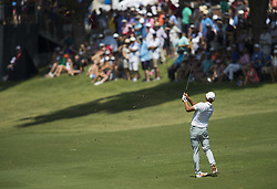May 26, 2018 - Fort Worth, TX, USA - FORT WORTH, TX - MAY 26, 2018 - Rickie Fowler hits his approach shot to the 18th green during the third round of the 2018 Fort Worth Invitational PGA at Colonial Country Club in Fort Worth, Texas (Credit Image: © Erich Schlegel via ZUMA Wire)