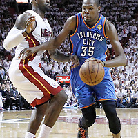 21 June 2012: Oklahoma City Thunder small forward Kevin Durant (35) drives past Miami Heat small forward LeBron James (6) during the second quarter of Game 5 of the 2012 NBA Finals, at the AmericanAirlinesArena, Miami, Florida, USA.