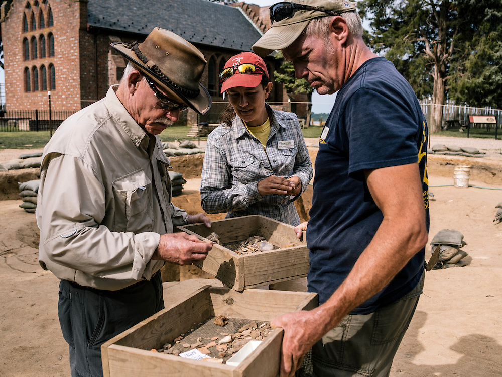 Jamestown lead archaeologist William Kelso, left, sifts through pieces of artifacts discovered in a new dig site at the Jamestown settlement in Va.