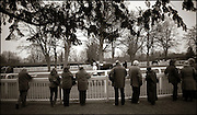 The last meeting at Folkestone Racecourse, Westenhanger, Kent, 18th December 2012..Punters look at the horses in the parade ring before the first race