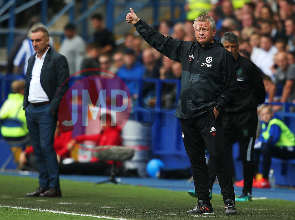 Sheffield United manager Chris Wilder gives a thumbs up ahead of a dejected Sheffield Wednesday manager Carlos Carvalhal - Mandatory by-line:  Matt McNulty/JMP - 24/09/2017 - FOOTBALL - Hillsborough - Sheffield, England - Sheffield Wednesday v Sheffield United - Sky Bet Championship