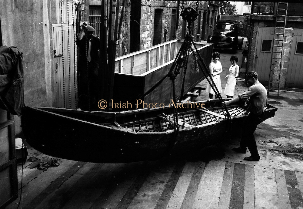 16/7/1964<br /> 7/16/1964<br /> 16  July 1964<br /> <br /> Packing a Currach to ship to Canada