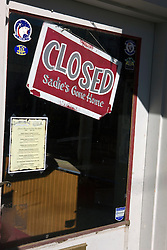 A shop in Virginia City, Nevada hanging a Closed sign in the door window.