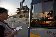 Tian'anmen Square (Place of Heavenly Peace). Bus dispatcher at the Quianmen.