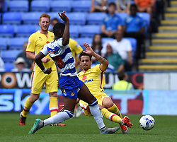 Diego Poyet of MK Dons challenges Aaron Tshibola of Reading - Mandatory by-line: Paul Knight/JMP - Mobile: 07966 386802 - 22/08/2015 -  FOOTBALL - Madejski Stadium - Reading, England -  Reading v MK Dons - Sky Bet Championship