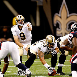 August 21, 2010; New Orleans, LA, USA; New Orleans Saints quarterback Drew Brees (9) points from under center during the first quarter of a preseason game against the Houston Texans at the Louisiana Superdome. Mandatory Credit: Derick E. Hingle
