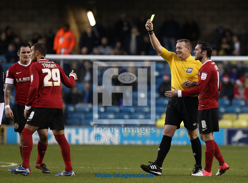 Picture by John  Rainford/Focus Images Ltd +44 7506 538356.22/12/2012.Marcus Tudgay of Barnsley is cautioned by referee Kettle during the npower Championship match at The Den, London.