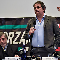 Como, Italy - 9 December 2017: Roberto Fiore, Italy's neo-fascist Forza Nuova leader, addresses the media during a press conference. Italy's Democrats led a rally at the same time a few hundreds meters away to warn about a comeback of fascist movements in the country.