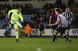 Paul Taylor of Peterborough United shoots at goal which is blocked by Ben Thompson of Millwall - Mandatory by-line: Joe Dent/JMP - 28/02/2017 - FOOTBALL - The Den - London, England - Millwall v Peterborough United - Sky Bet League One