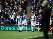 Manchester United's Manager Jose Mourinho watches as Huddersfield players celebrate the goal scored by Huddersfield Town's Aaron Mooy during the Premier League match between Huddersfield Town and Manchester United at the John Smiths Stadium, Huddersfield, England on 21 October 2017. Photo by Paul Thompson.