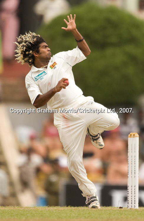 Lasith Malinga bowls during the first Test Match between Sri Lanka and England at the Asgiriya Stadium, Kandy. Photograph © Graham Morris/cricketpix.com (Tel: +44 (0)20 8969 4192; Email: sales@cricketpix.com)