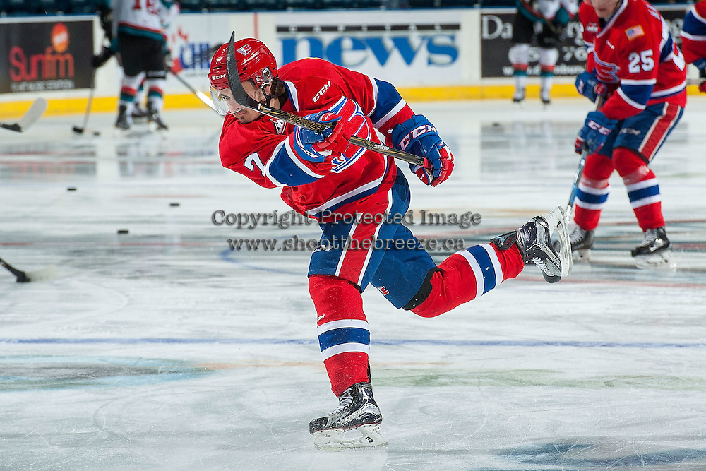 KELOWNA, CANADA - JANUARY 4: Nolan Reid #7 of the Spokane Chiefs takes a shot during warm up against the Kelowna Rockets on January 4, 2017 at Prospera Place in Kelowna, British Columbia, Canada.  (Photo by Marissa Baecker/Getty Images)  *** Local Caption ***