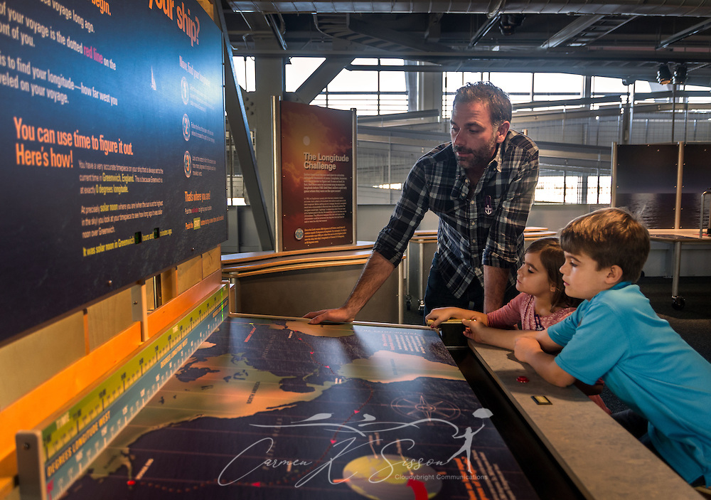 A father helps his children as they explore an interactive exhibit at GulfQuest National Maritime Museum of the Gulf of Mexico,  November 27, 2015, in Mobile, Alabama. The museum opened in September 2015 and features more than 90 interactive exhibits celebrating the  Gulf Coast's rich maritime heritiage. (Photo by Carmen K. Sisson/Cloudybright)