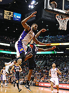 Mar. 1, 2013; Phoenix, AZ, USA; Phoenix Suns forward Marcus Morris (15) is flagrantly fouled by Atlanta Hawks  guard Jeff Teague (0) in the second half at US Airways Center. The Suns defeated the Hawks 92-87. Mandatory Credit: Jennifer Stewart-USA TODAY Sports