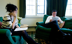 Leader of the Conservative Party David Cameron with Clare Foges his  chief political speech writer, who wrote his speech on europe, in his office in Norman Shaw South, Wednesday March 31, 2010. Photo By Andrew Parsons / i-Images