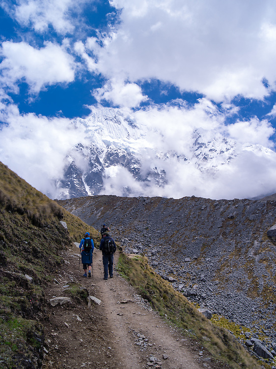 Hiking on the Camino Salkantary, with Montaña Salkantay and its glacier in the background, near Soraypampa, Peru.