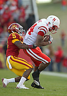 November 06 2010: Nebraska Cornhuskers wide receiver Brandon Kinnie (84) is pulled down by Iowa State Cyclones cornerback Jeremy Reeves (5) during the second half of the NCAA football game between the Nebraska Cornhuskers and the Iowa State Cyclones at Jack Trice Stadium in Ames, Iowa on Saturday November 6, 2010. Nebraska defeated Iowa State 31-30.