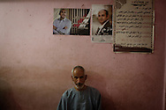 EGYPT, Cairo: A man sits in a barber shop in the hometown village of independent presidential candidate Khaled Ali, in Daqalya province  on May 17, 2012. ph. Christian Minelli.