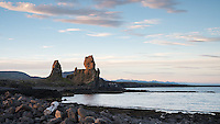 Lóndrangar rock pinnacles at Snæfellsnes Peninsula, West Iceland. They are volcanic plugs of basalt, that have been hewn out from softer surrounding rock by erosion (75 and 61 m tall).