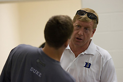 26 May 2007: Duke Blue Devils head coach John Danowski (white shirt) with attackman Matt Danowski (40)in the locker room before the NCAA semifinals to take on the Cornell Big Red at M&T Bank Stadium in Baltimore, MD.