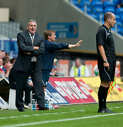 CARDIFF, WALES - Sunday, August 8, 2010: Cardiff City's Kenny Jackett argues with the assistant referee after the linesman disallowed a goal for off-side against Sheffield United during the League Championship match at the Cardiff City Stadium. (Pic by: David Rawcliffe/Propaganda)