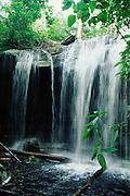 Waterfall in Tropical Rain Forest, Cachoeira da Sussuarana, Amazon region, Amazonas State, Brazil.
