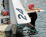 United States Coast Guard Academy swab Jessica Lukasik, 18, of Lawrenceville, GA, right, struggles to right her capsized sailboat with crewmate Moira McNeil, 18, of Littleton, CO, as part of sail training Tuesday, July 6, 2010. (Sean D. Elliot/The Day)