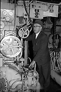 02/06/1964 <br /> 06/02/1964<br /> 02 June 1964<br /> Mr. C.M. Grace, Engineer Superintendent , Palgrave Murphy Shipping Ltd., at the Liffey Dockyard. Mr Grace examining and engine.