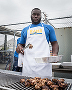 Los Angeles Rams defensive tackle Marquise Copeland barbeques during community improvement project at Belvedere Elementary School to upgrade play and social spaces around the school by building a new playground structure, painting murals and basketball backboards and landscaping., Friday, June 14, 2019, in Los Angeles, Calif. (Ed Ruvalcaba/Image of Sport)