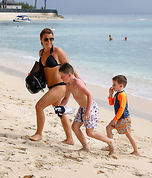 EXCLUSIVE: NO WEB UNTIL 1345 GMT 22ND MAY* Wayne and Coleen Rooney and family are spotted on the beach in Barbados. ***SPECIAL INSTRUCTIONS*** Please pixelate children's faces before publication.***. 18 May 2018 Pictured: Coleen Rooney, Wayne Rooney, Kai Rooney. Photo credit: Vantagenews.com / MEGA TheMegaAgency.com +1 888 505 6342