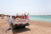 Local transport, Tourists  in a pickup truck. Blue Lagoon (Dahab), Sinai, Egypt