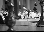 Episcopal Ordination Of Desmond Connell. (R74).1988..06.03.1988..03.06.1988..6th March 1988..Following the death of Archbishop Kevin McNamara in April '87, Pope John Paul II surprisingly nominated Desmond Connell for the position of Archbishop of Dublin. The ordination of Dr Connell took place at the Pro-Cathedral in Dublin...Image shows Dr Desmond Connell being conferred with the title of Archbishop of Dublin by the Papal Nuncio during the ceremony.