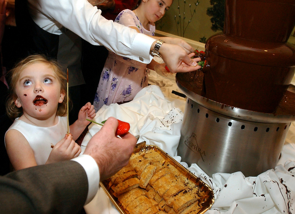 A chocolate lover at a wedding.