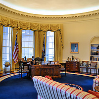 Oval Office at William Clinton Presidential Library in Little Rock, Arkansas<br /> The William J. Clinton Presidential Library in Little Rock, Arkansas, is the most expensive of the 13 libraries, plus it is the largest in space and number of archives.  The main building in the park cantilevers over the Arkansas River.  The large timeline panels and alcoves on the second floor tell the story of his presidency.  It also includes a full-scale replica of his Oval Office.