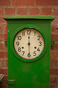 Green station clock set to 12:30