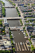 Nederland, Noord-Holland, Amsterdam, 14-06-2012; Amstel met bij het Amstelhotel de Hogesluis (wordt gerenoveerd), theater Carre (b,l) en de Torontobrug..The river Amstel with its sluices and bridges, Amsterdam center. Amstel Hotel (m, l)..luchtfoto (toeslag), aerial photo (additional fee required).foto/photo Siebe Swart