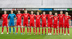 NEWPORT, WALES - Tuesday, October 16, 2018: Wales line up for the anthems ahead of the UEFA Under-21 Championship Italy 2019 Qualifying Group B match between Wales and Switzerland at Rodney Parade. Left-right: captain Regan Poole, Owen Evans, Cian Harries, Keston Davies, Rhys Norrington-Davies, Robbie Burton, Nathan Broadhead, Connor Evans, , Joseff Morrell, Thomas Harris and Aaron Lewis (Pic by Laura Malkin/Propaganda)