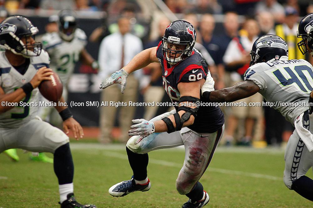 September 29, 2013: Houston, TX, USA - Houston Texans defensive end J.J. Watt (99) rushes the passer during the fourth quarter at Reliant Stadium in Houston, Texas, Sunday, September 29, 2013. Seattle defeated Houston 23-20.
