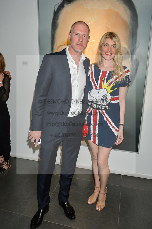 JEAN DAVID MALAT and MEREDITH OSTROM at a private view of woks by German artist Mike Dargas held at the Opera Gallery, 134 New Bond Street, London on 5th July 2016.