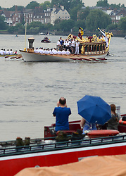© Licensed to London News Pictures. 27/07/2012. Hammersmith, UK The boat that lead the Royal Jubilee, The Gloriana, carries the Olympic flame on The Thames River towards Central London today through Hammersmith Bridge on it's way to the Olympic Opening Ceremony that takes place tonight at 20:12 27th July 2012. Photo credit : Stephen Simpson/LNP