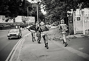 Punks running, UK, 1980s,