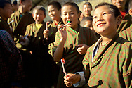 Medical mission trip to Bhutan working in remote rural village teaching boys to brush teeth