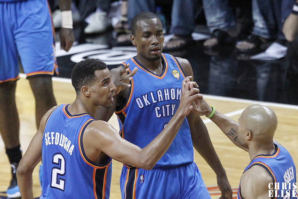 17 June 2012: Oklahoma City Thunder point guard Derek Fisher (37) is congratulated by Oklahoma City Thunder shooting guard Thabo Sefolosha (2) and Oklahoma City Thunder power forward Serge Ibaka (9) during the Miami Heat 91-85 victory over the Oklahoma City Thunder, in Game 3 of the 2012 NBA Finals, at the AmericanAirlinesArena, Miami, Florida, USA.
