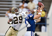 JACKSON, MS - AUGUST 26:  Safety Josh Bullocks of the New Orleans Saints goes up to block a pass to tight end Dallas Clark of the Indianapolis Colts on August 26, 2006 at Veterans Memorial Field in Jackson, Mississippi.  (Photo by Wesley Hitt/Getty Images) *** Local Caption *** Josh Bullocks.and Dallas Clark