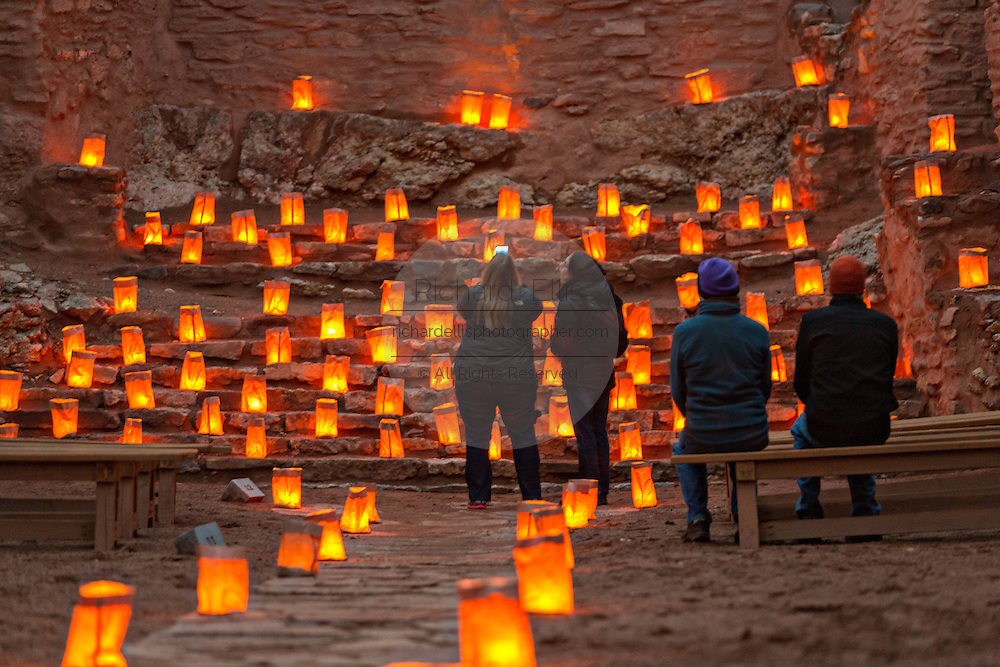 Visitors view the ruins of the San José de los Jémez Mission part of the Jemez Historic Site illuminated by hundreds of small paper lanterns known as luminaria to celebrate the holiday season December 12, 2015 in Jemez Springs, New Mexico. The site is in the Jémez Indian pueblo and contains an early 17th-century mission complex.