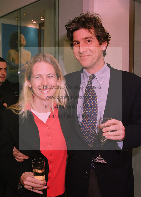 MR RUPERT & the HON.MRS SCOTT she is the daughter of Lord Montagu of Beaulieu, at a party in London on 21st April 1998.MGT 44