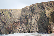 Complex folding of sedimentary rock strata in coastal cliffs at Hartland Quay, north Devon, England