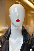 red lips mannequin head in a window display