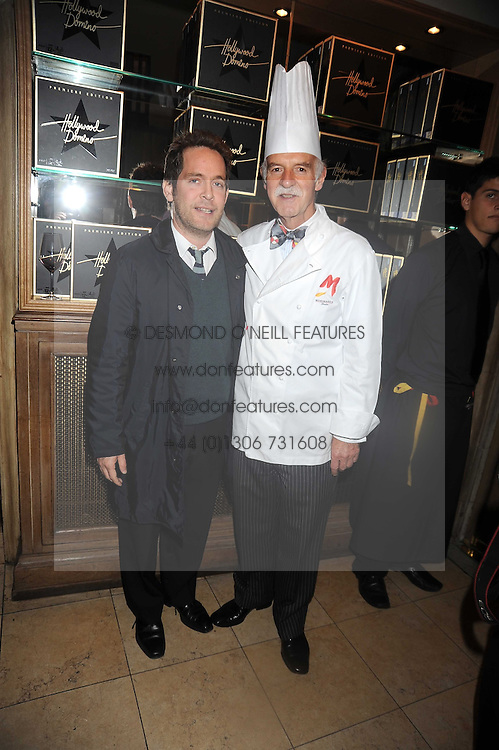 Left to right, TOM HOLLANDER and ANTON MOSIMANN at a party to celebrate the launch of Hollywood Domino - a brand new board game, held at Mosimann's 11b West Halkin Street, London on 7th November 2008.  The evening was in aid of Charlize Theron's Africa Outreach Project.