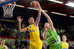 Marcus Eriksson of Sweden vs Gezim Morina of Slovenia during basketball match between National teams of Sweden and Slovenia in First Round of U20 Men European Championship Slovenia 2012, on July 13, 2012 in Domzale, Slovenia. (Photo by Vid Ponikvar / Sportida.com)